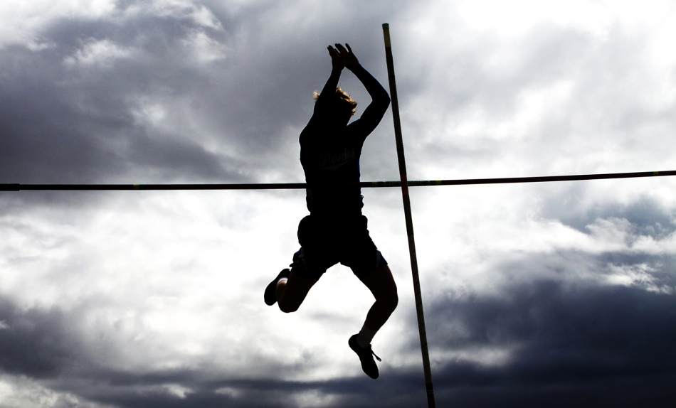 Havre, Montana. Gunnar Aageson pole vaults at the Havre Invitational Track Meet.
