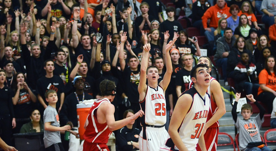 Elida no. 25 Aric Thompson and other players and fans watches Thompson's 3-point-shot heads toward the net during Friday night's boys sectional division II basketball tournament game against Wapakoneta at Lima Senior. Thompson's 3-pointer put Elida ahead 37-34 late in the fourth quarter.  Lindsay Brown/The Lima News